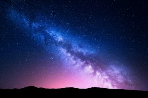 Milky Way Galaxy over hills