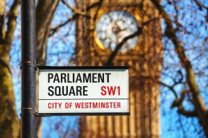 LONDON - APRIL 12: Parliament square sign in city of Westminster on April 12 2015 in London UK. It's a square at the northwest end of the Palace of Westminster in London.